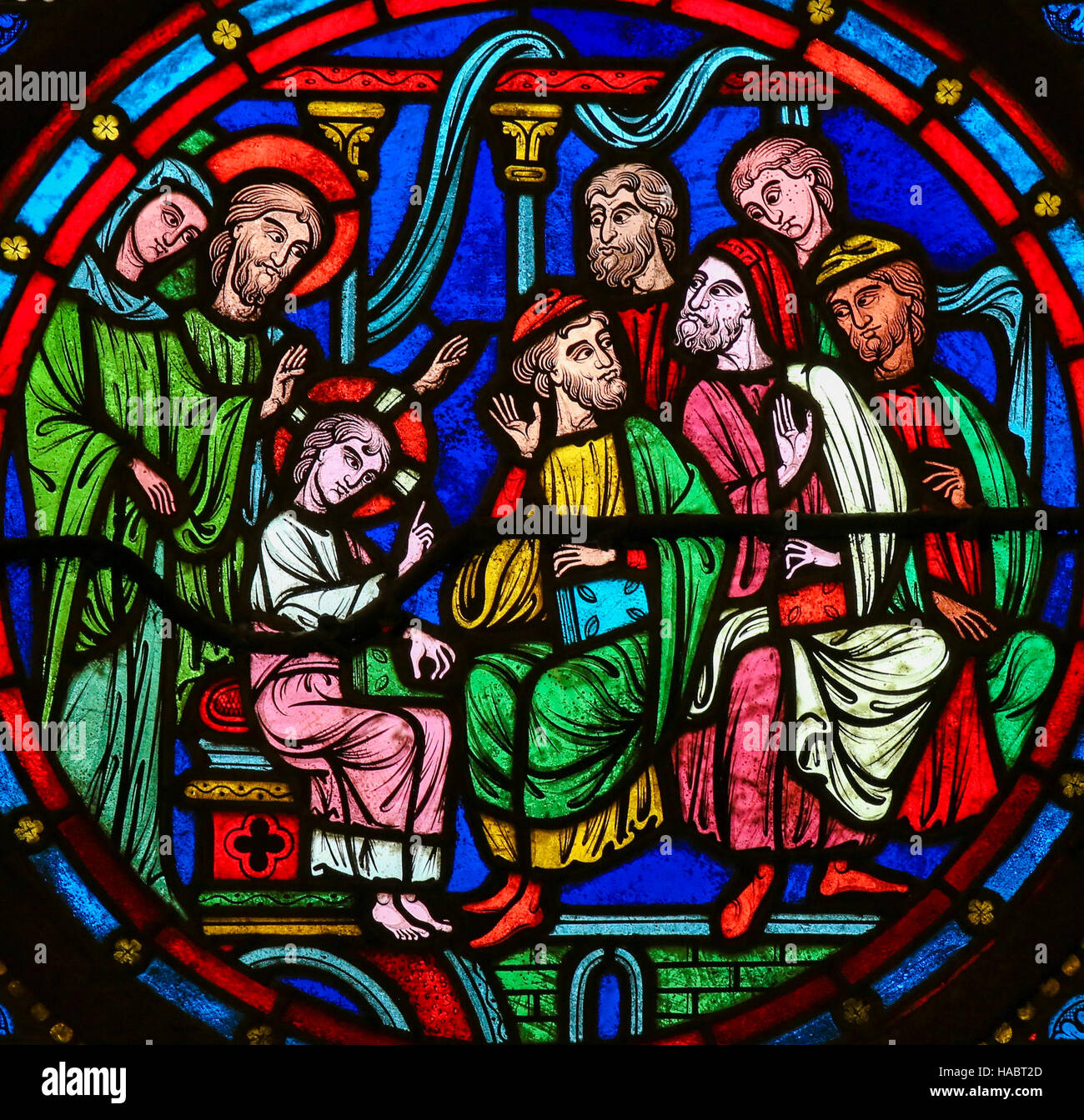 Stained Glass window in the Cathedral of Bayeux, France, depicting Christ among the Doctors in the Temple in Jerusalem - Stock Image