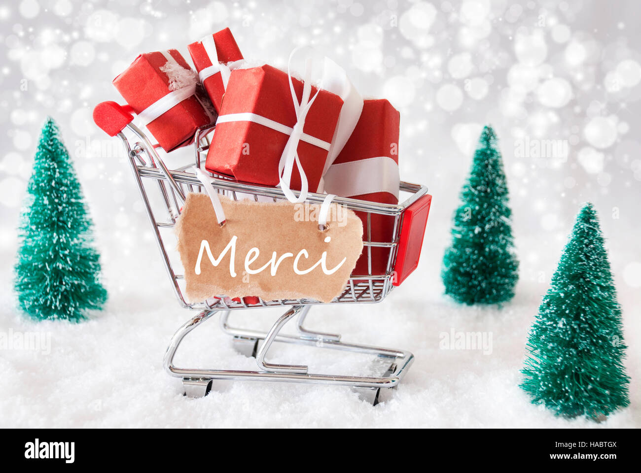 Trolly With Christmas Gifts And Snow, Merci Means Thank You Stock ...