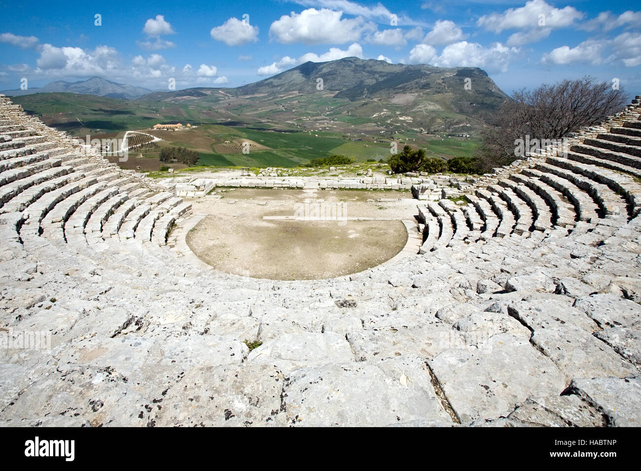 ancient Greek stone theatre ruins view on scenic panorama background, Segesta, Sicily, Italy Stock Photo
