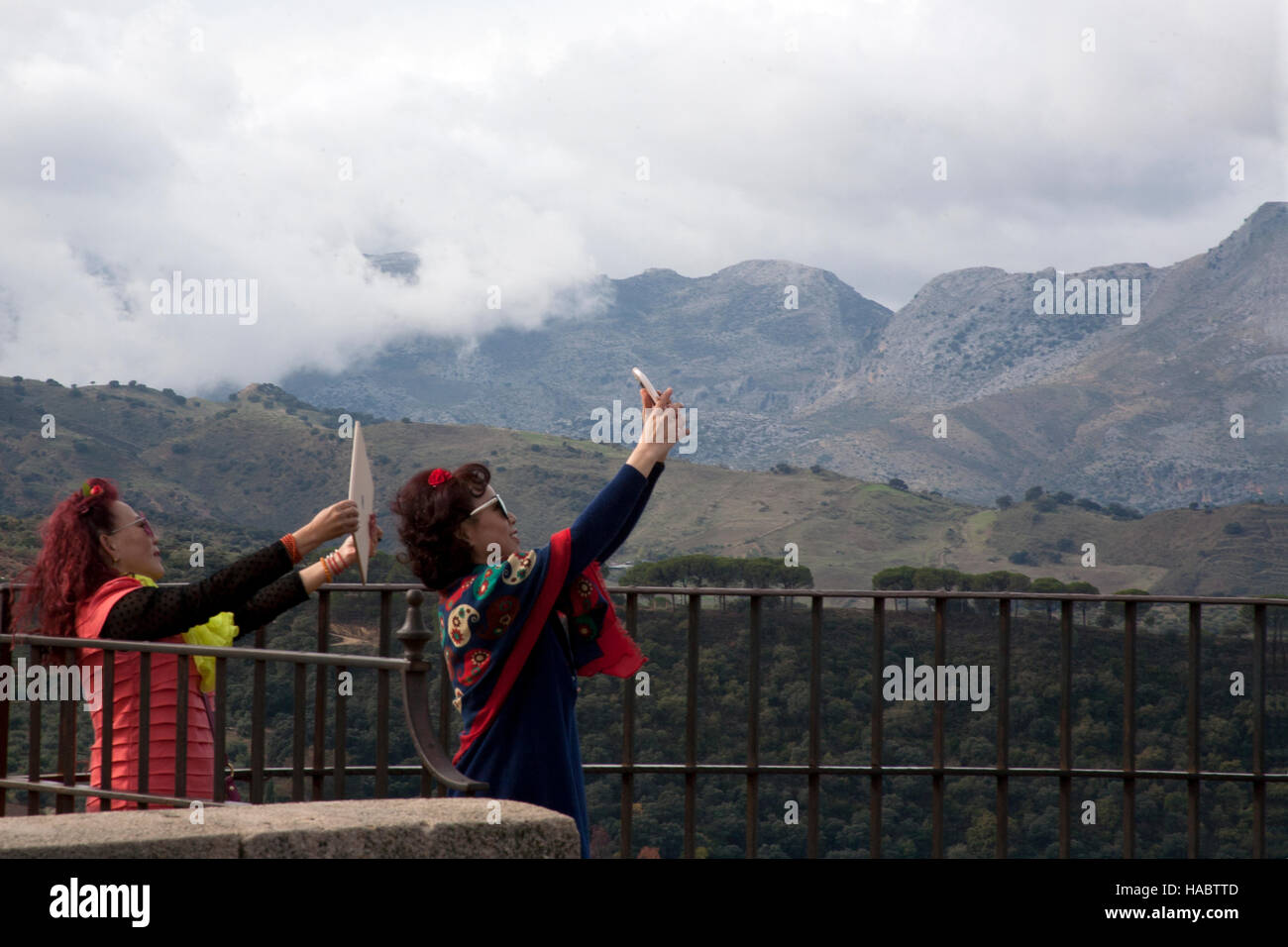Two tourists taking selfies Serranía de Ronda mountain range, Andalucia Spain - Stock Image
