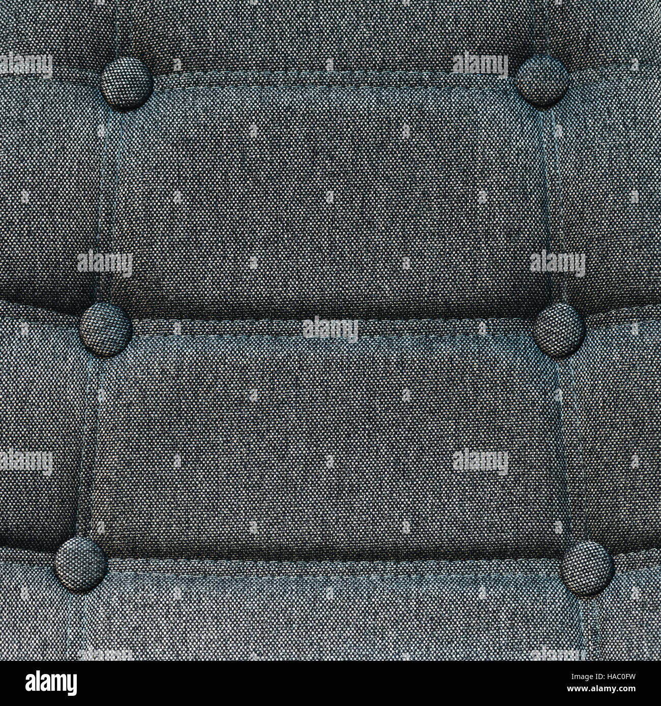 Buttoned chair back support detail, gray fiber material texture - Stock Image