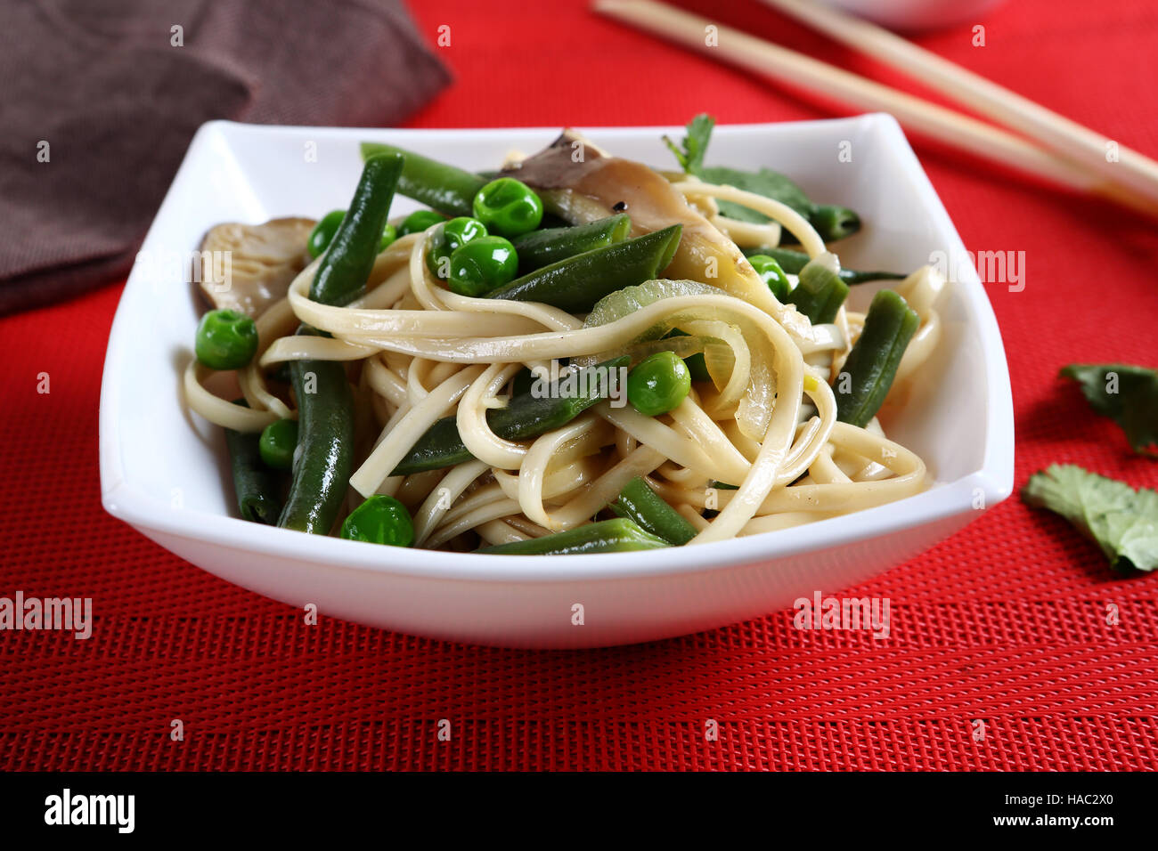 Tasty noodles with green beans, food - Stock Image