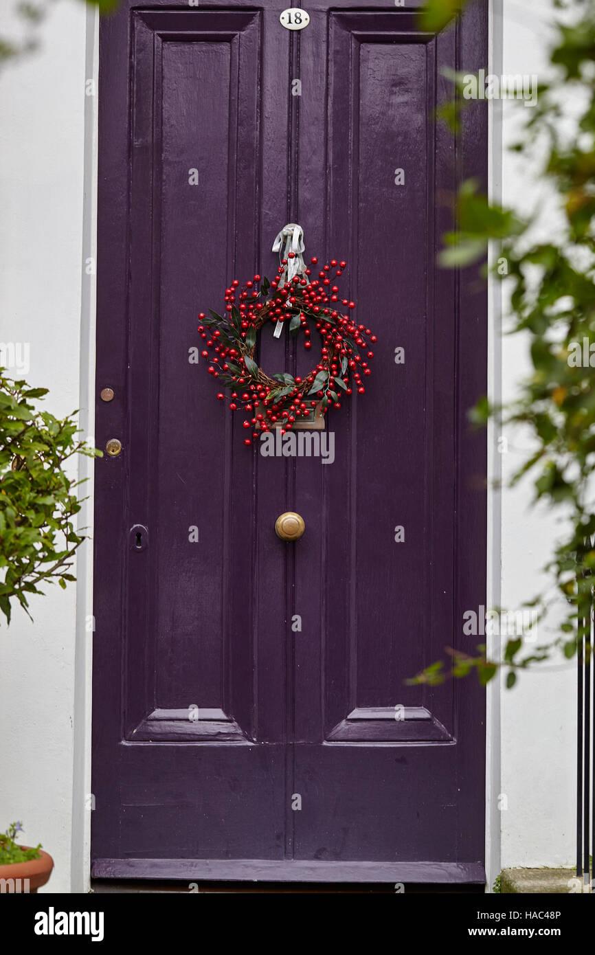 Red Berries Christmas Wreath On Front Door Stock Photo 126885942