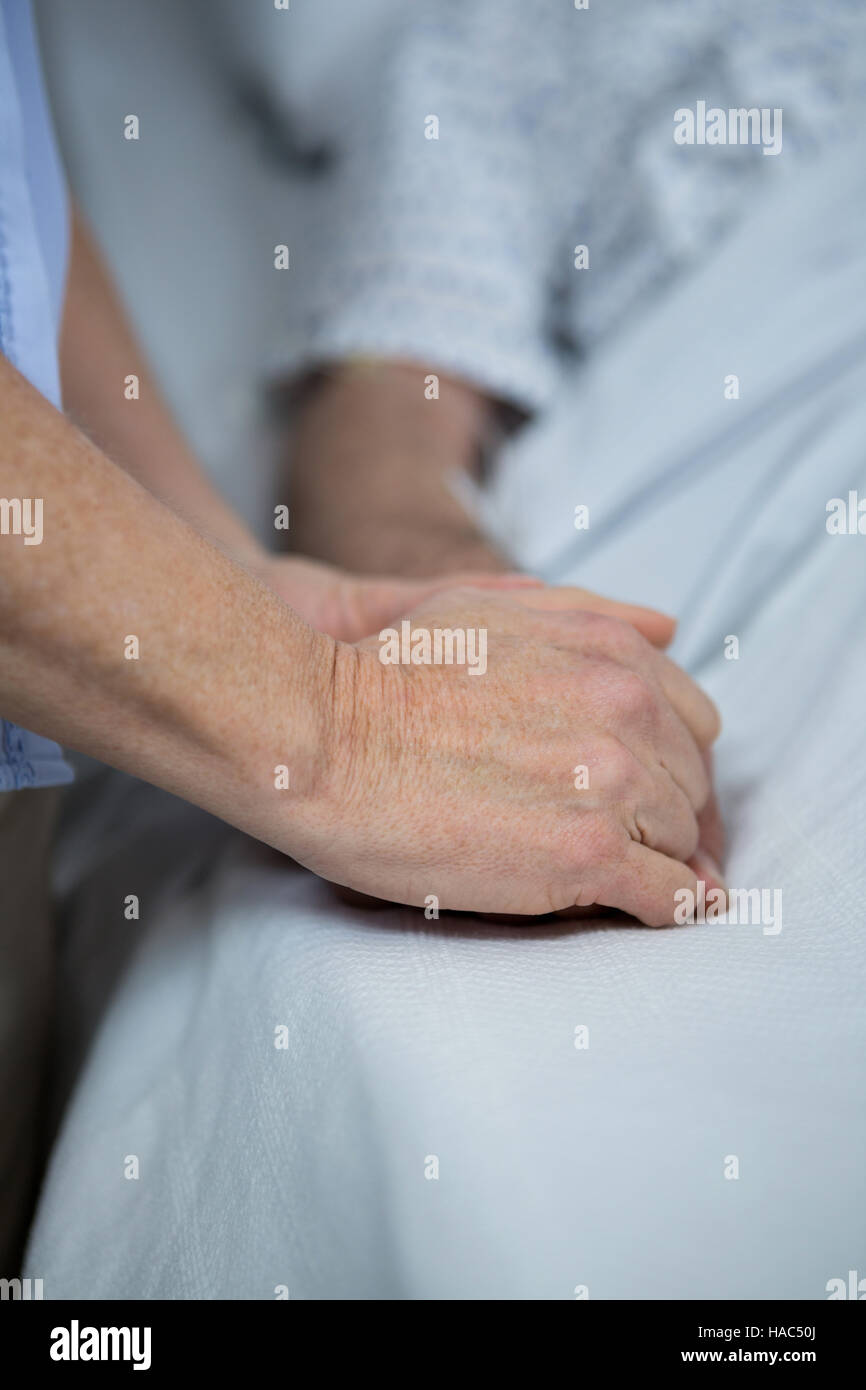 Doctor consoling a patient - Stock Image