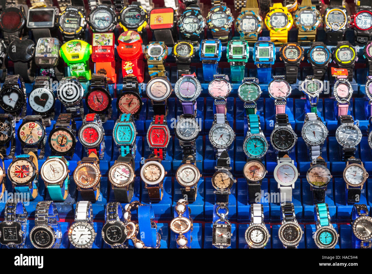 Colorful watches for sale on a street in Kathmandu - Stock Image