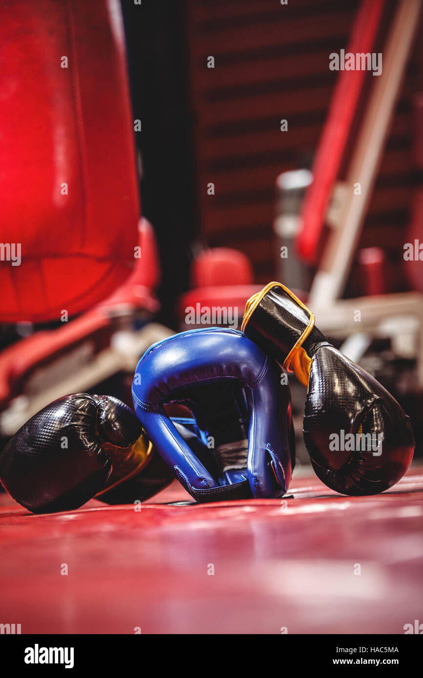 Boxing headgear and pair of gloves - Stock Image
