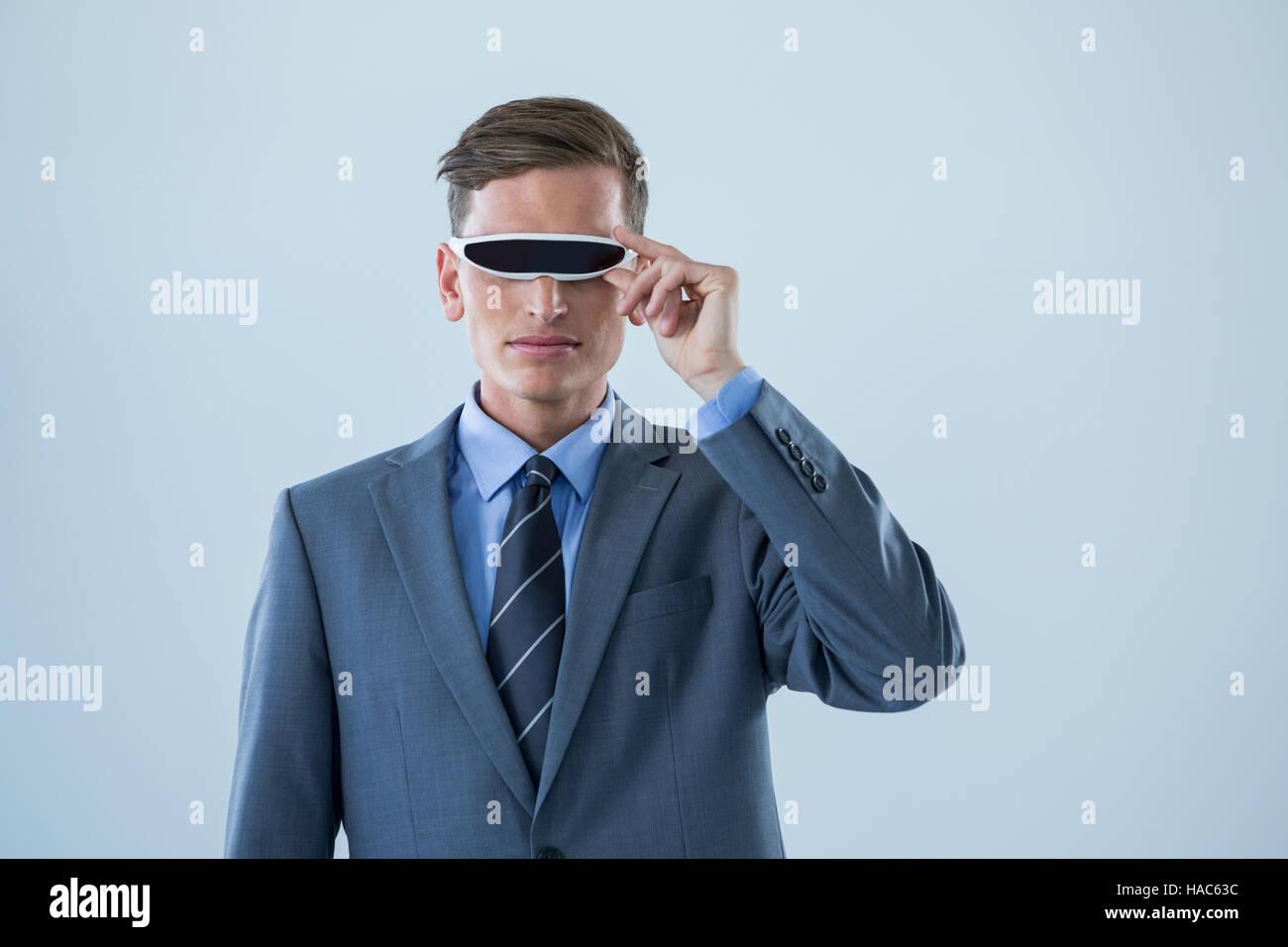 Businessman using virtual reality glasses - Stock Image