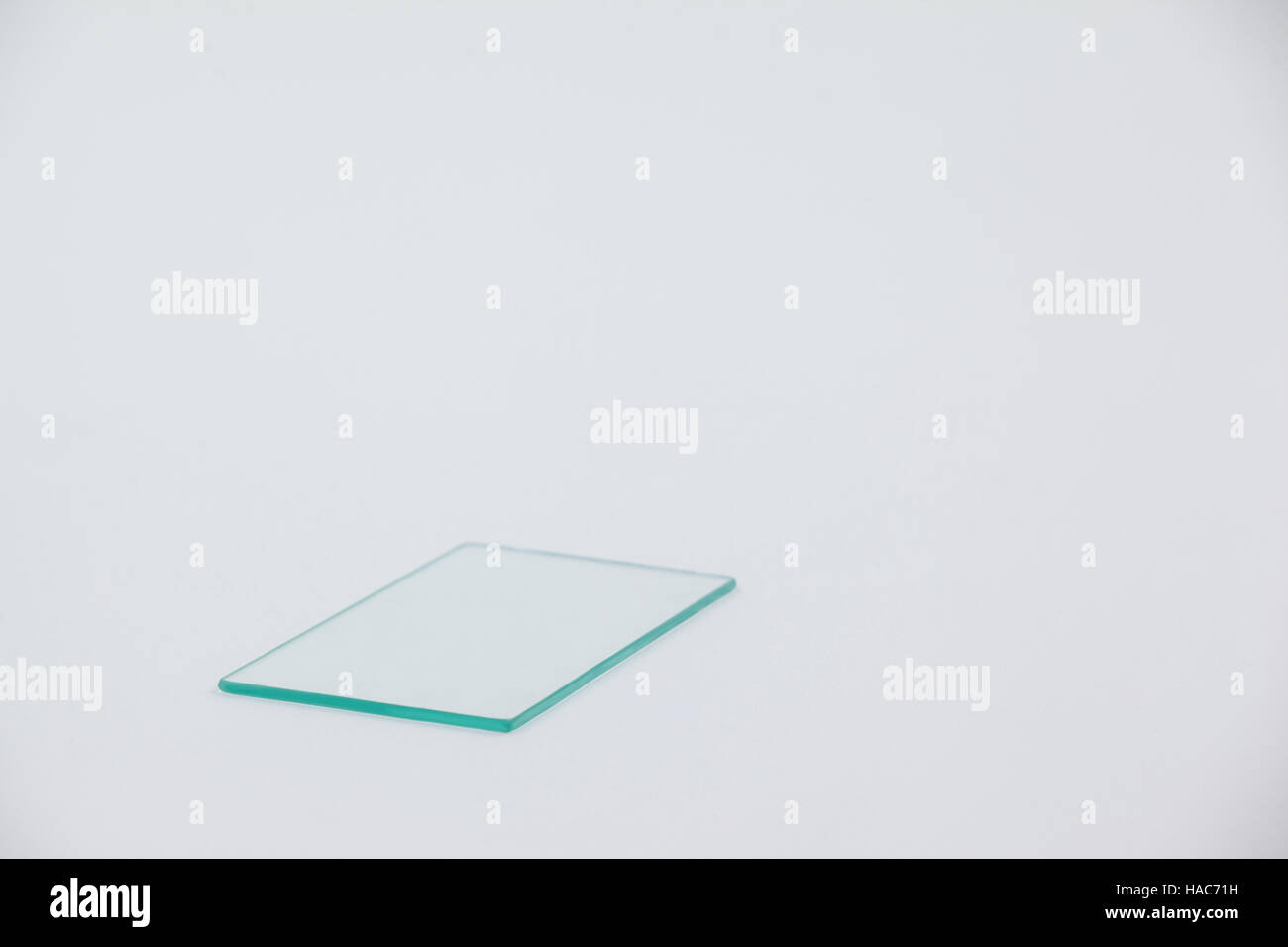 Sheet of glass on white background - Stock Image