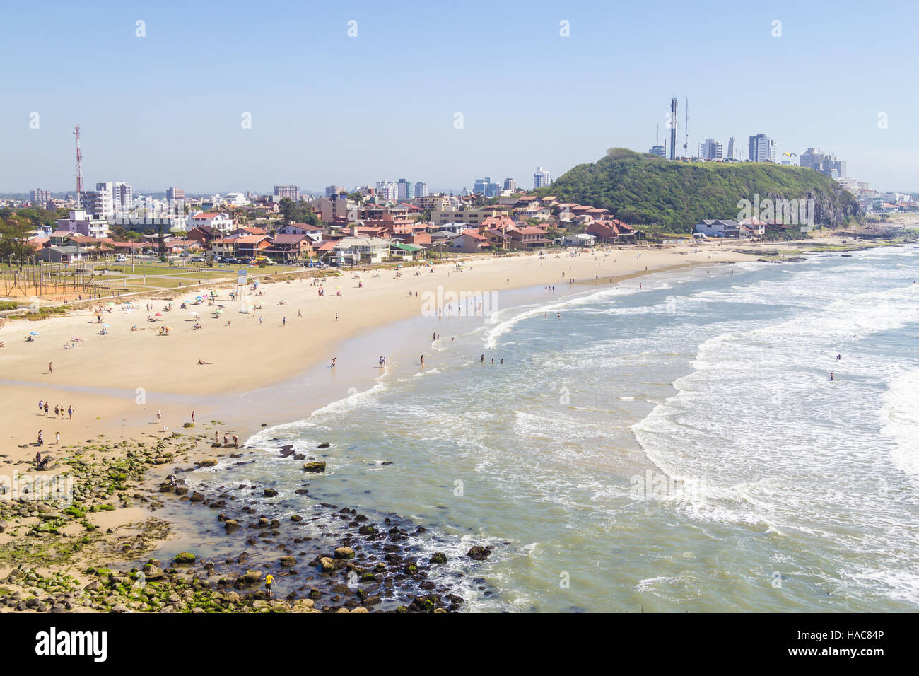 Sunny day with waves and blue sky at Cal beach, Torres, Rio Grande do Sul. - Stock Image