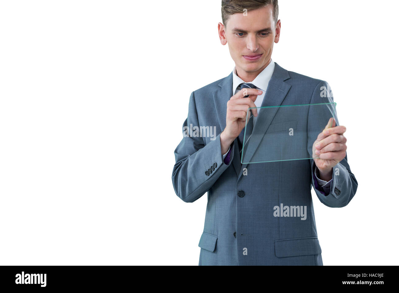 Businessman looking at glass sheet - Stock Image