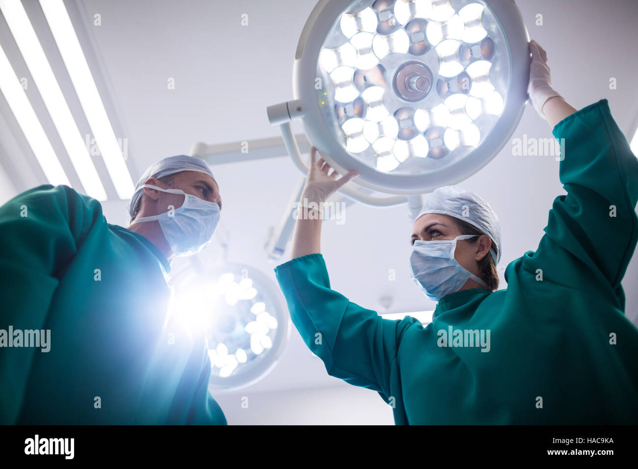 Surgeons using computer monitor in operation room - Stock Image