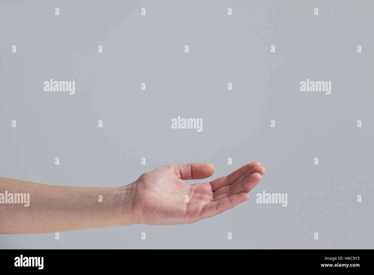 Cupped hand of a woman - Stock Image