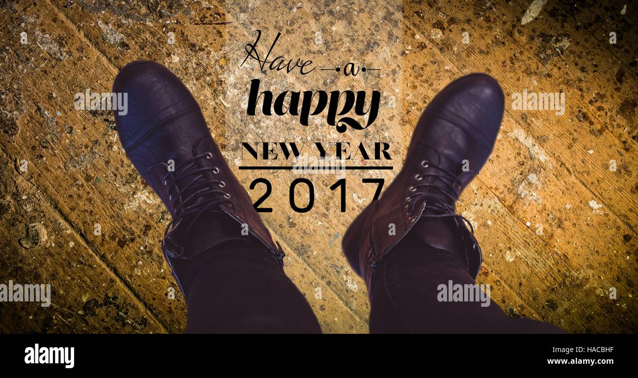 2017 new year wishes against black boots stock image
