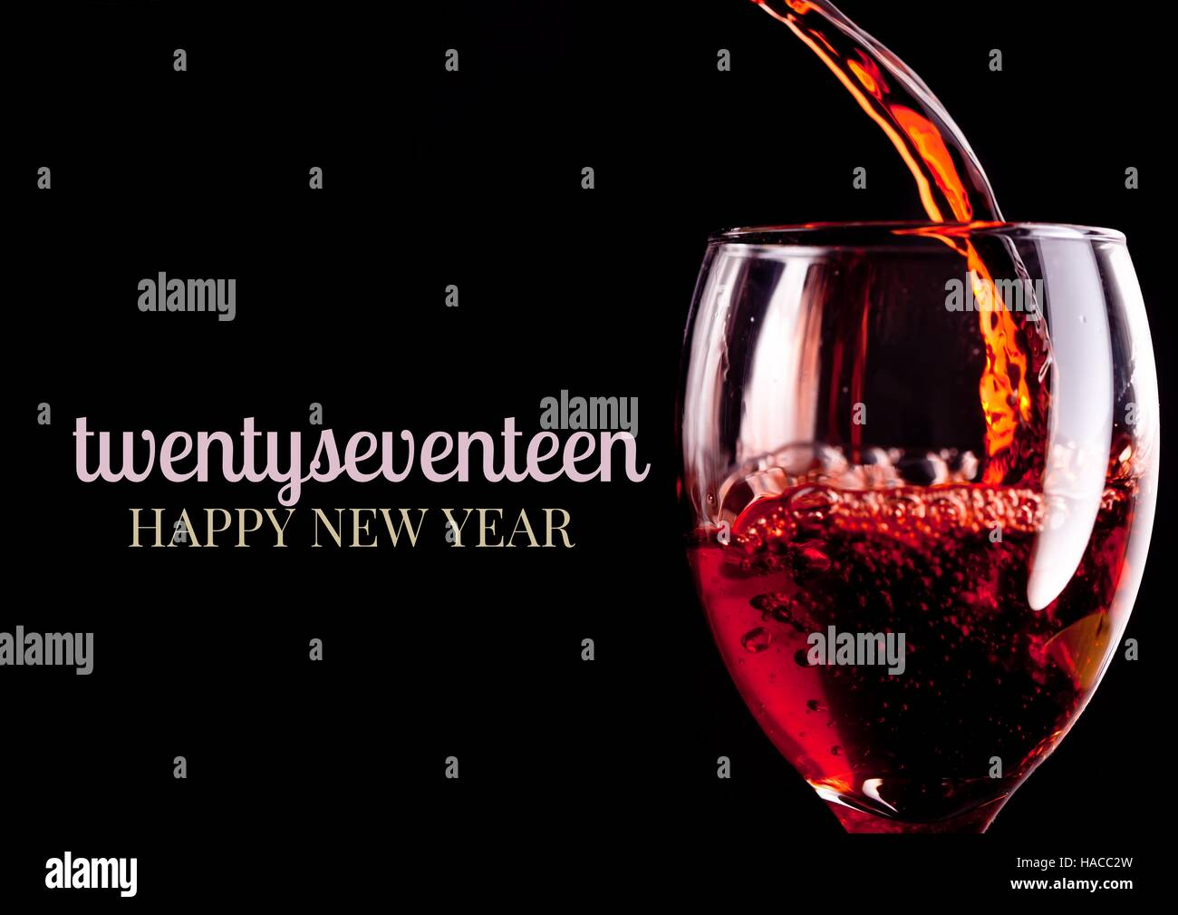 close up of 2017 happy new year wishes with red wine glass