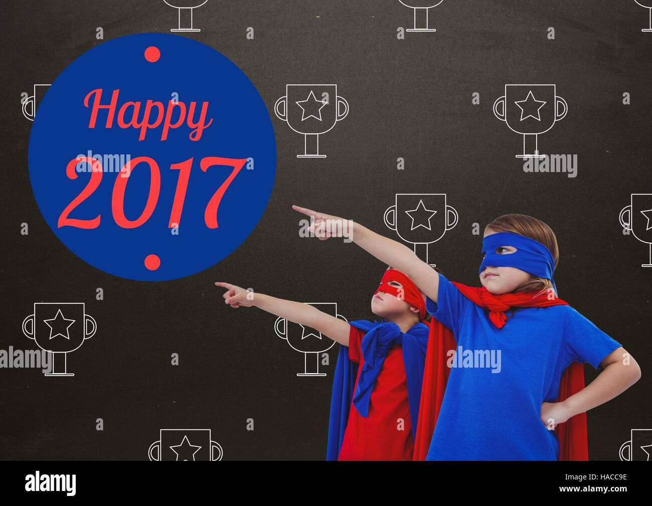 Children In Super Hero Costumes Pointing At New Year Greeting Quotes