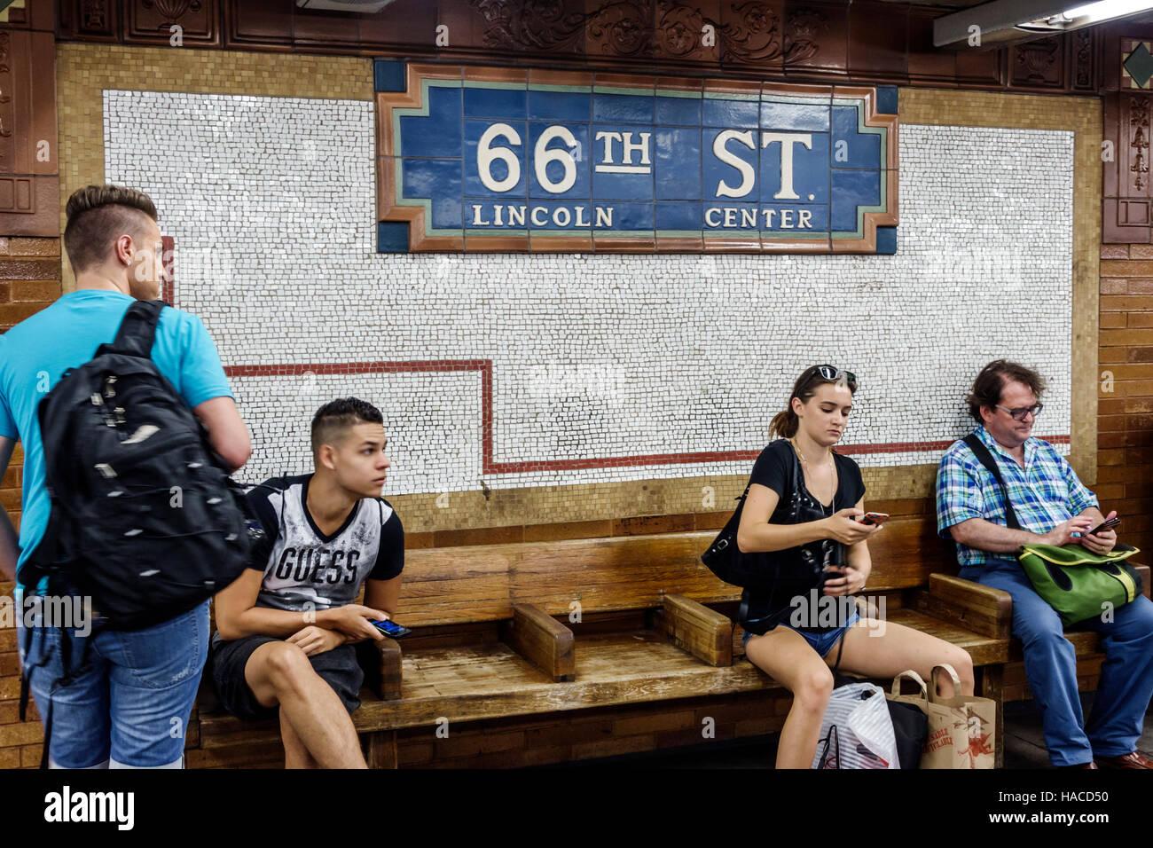 Manhattan New York City NYC NY Upper West Side 66th Street Lincoln Center Station subway platform Hispanic woman - Stock Image