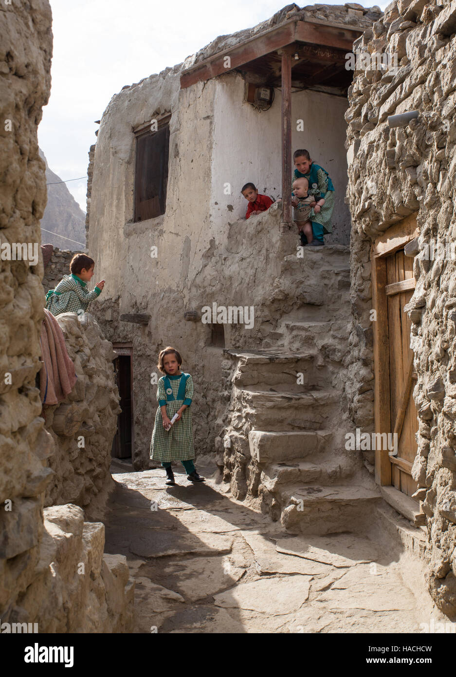 Muslim schoolgirls in school uniform, living in a traditional village is preparing to go to school - Stock Image