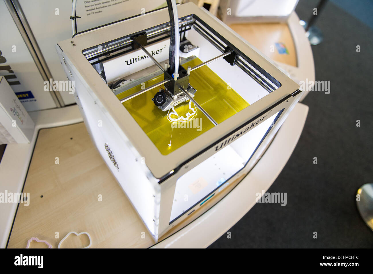 An 'Ultimaker 2' 3D printer, in use printing a cookie cutter - Stock Image