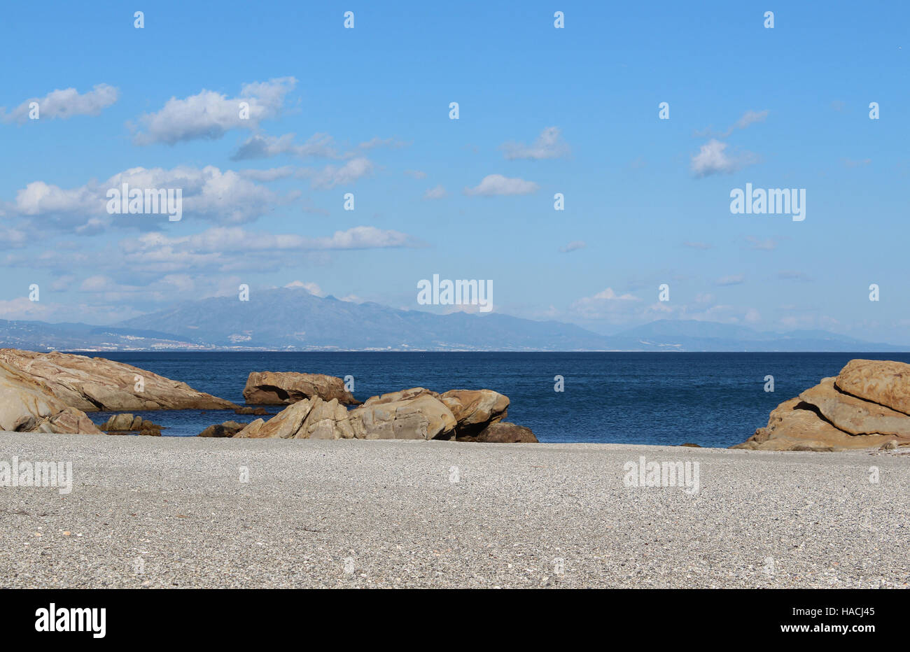 calm partly cloudy day on the beach - Stock Image