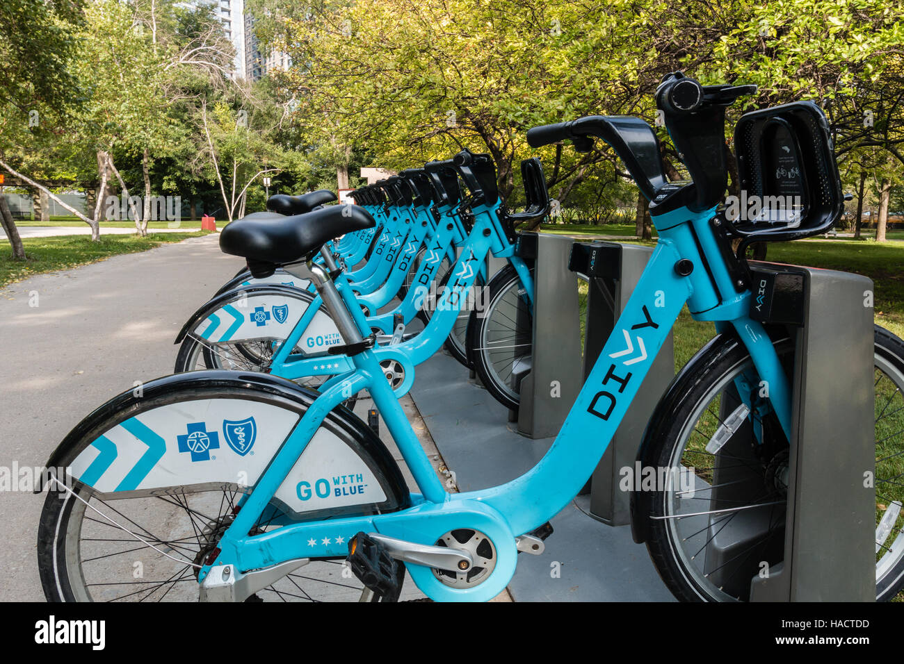 Shared bikes to rent are  the new way to commute in Chicago.  Divvy offers cycles to rent at many locations - Stock Image