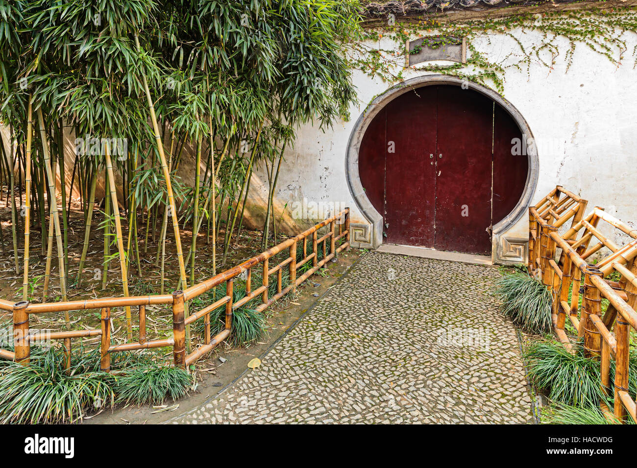 Formal traditional chinese garden - white surrounding wall with ...