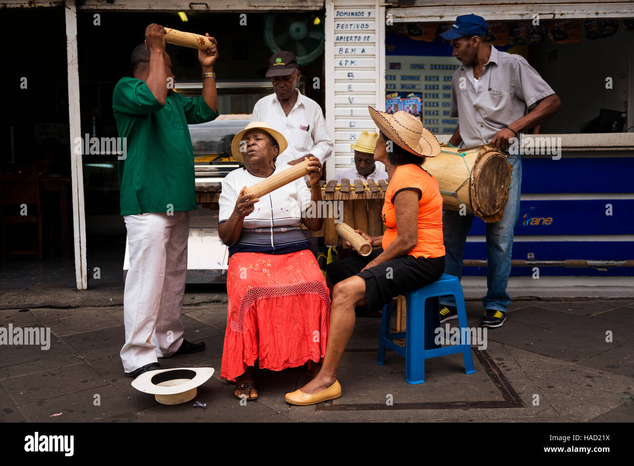 Cali, Colombia - February 6, 2014: Street musicians playing in a street in the city of Cali, in Colombia Stock Photo