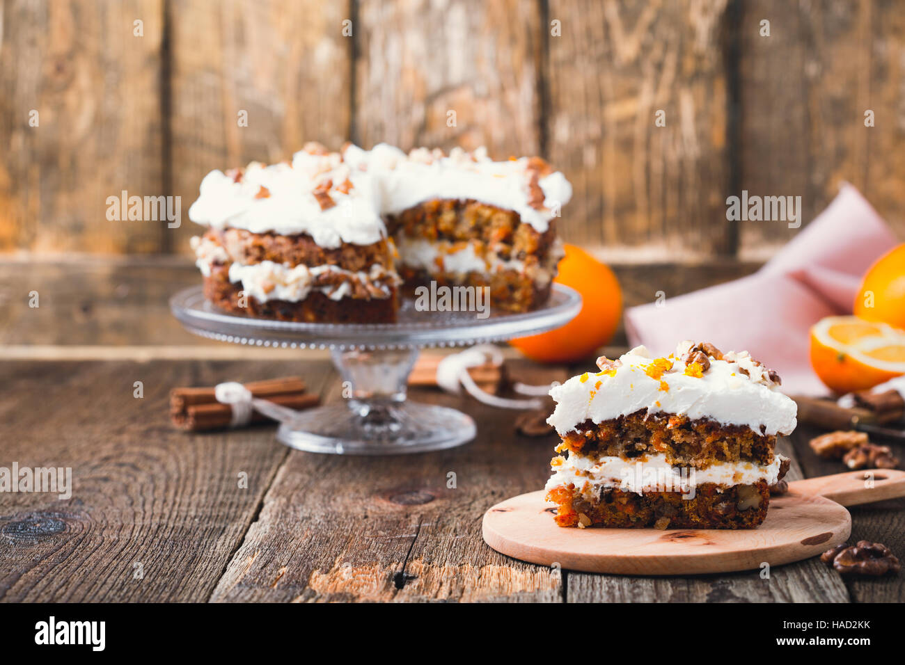 Homemade carrot orange cake with cream cheese frosting, traditional american afternoon tea treat Stock Photo