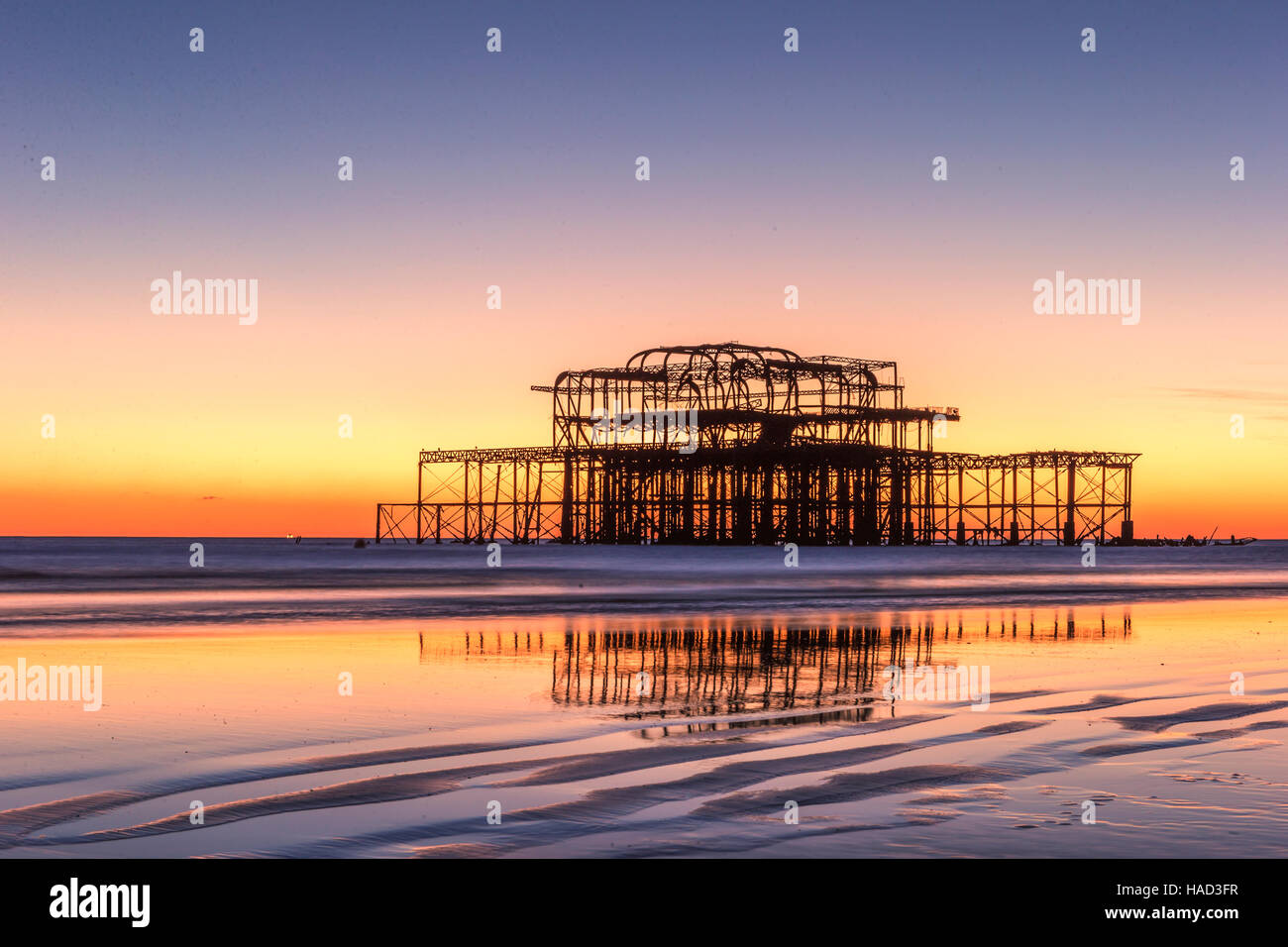 Brighton's burnt out West Pier at sunset UK Stock Photo