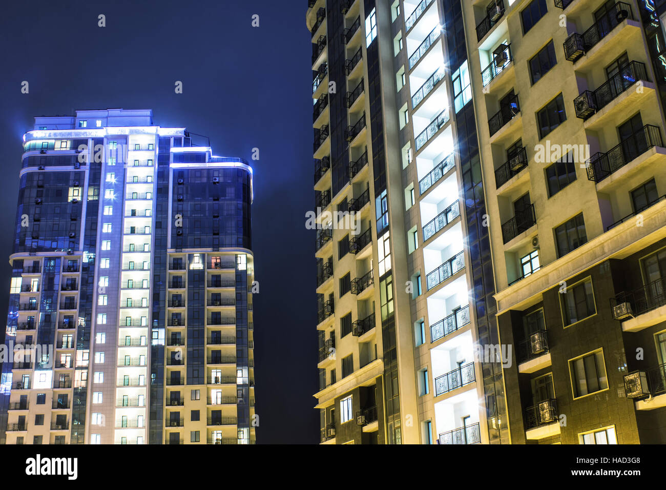 high-rise buildings at night with illumination - Stock Image