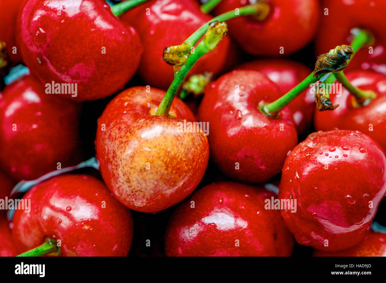 Fresh red cherries background texture. Cherry fruit, Close up - Stock Image
