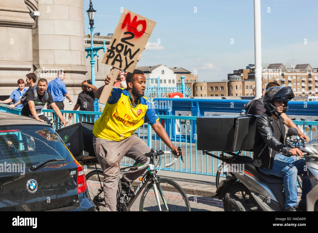 England, London, No to Low Pay Demonstrator on Bicycle - Stock Image