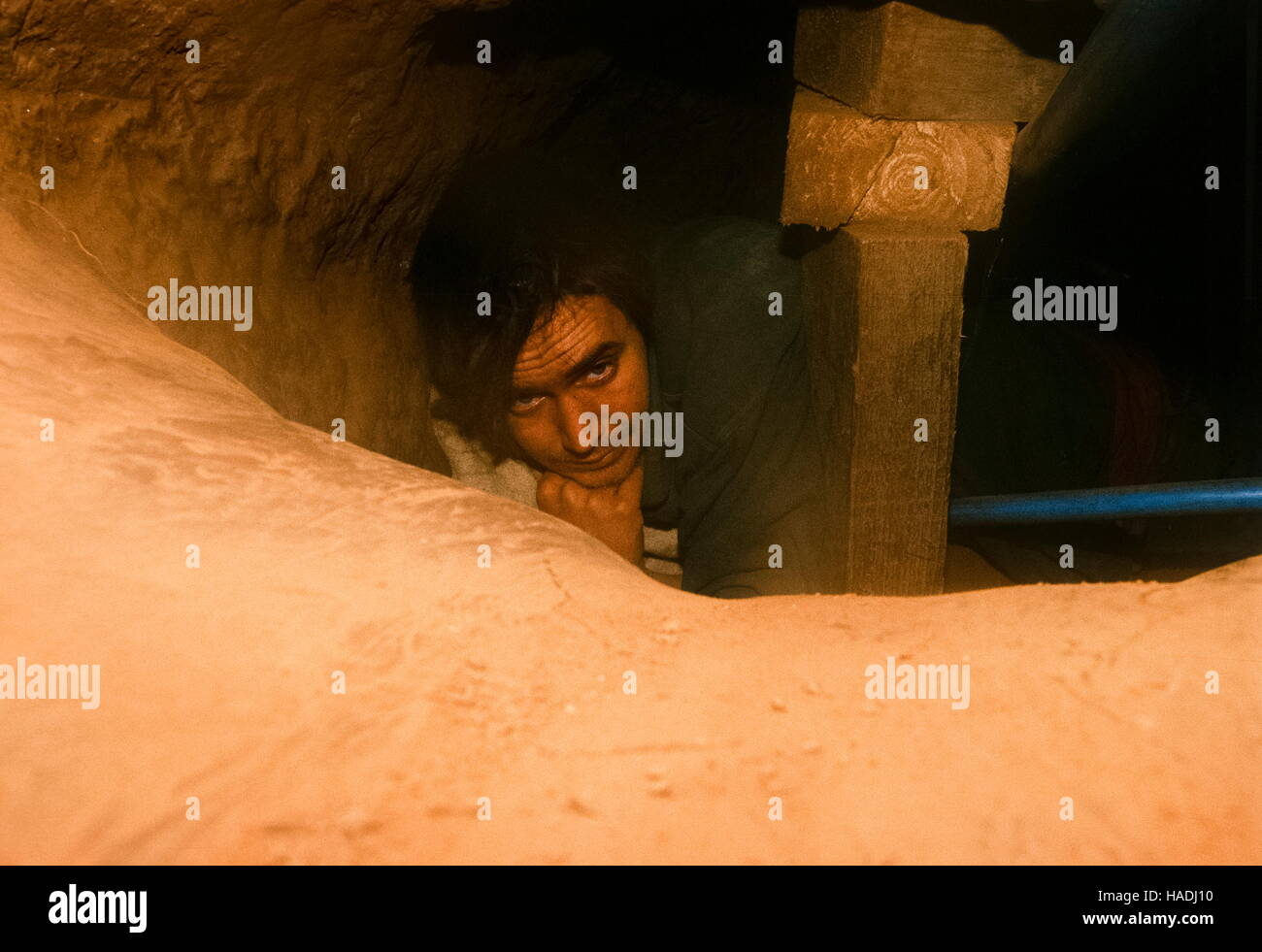 Swampy also known as  Daniel Cooper in a protest tunnel he built at the Manchester Airport Runway protest. - Stock Image