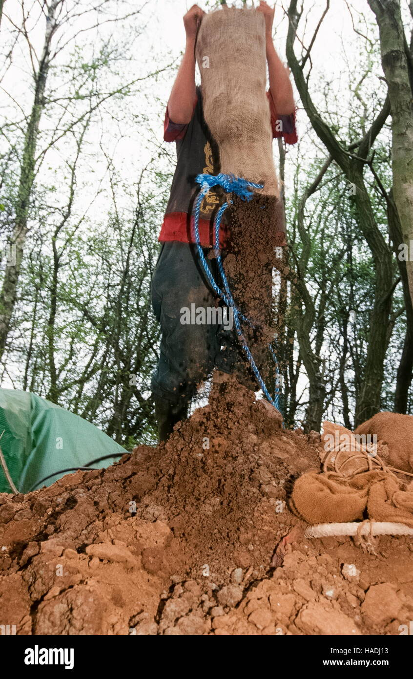 Emptying  mud from the tunnels built to stop the Manchester Airport expansion - Stock Image