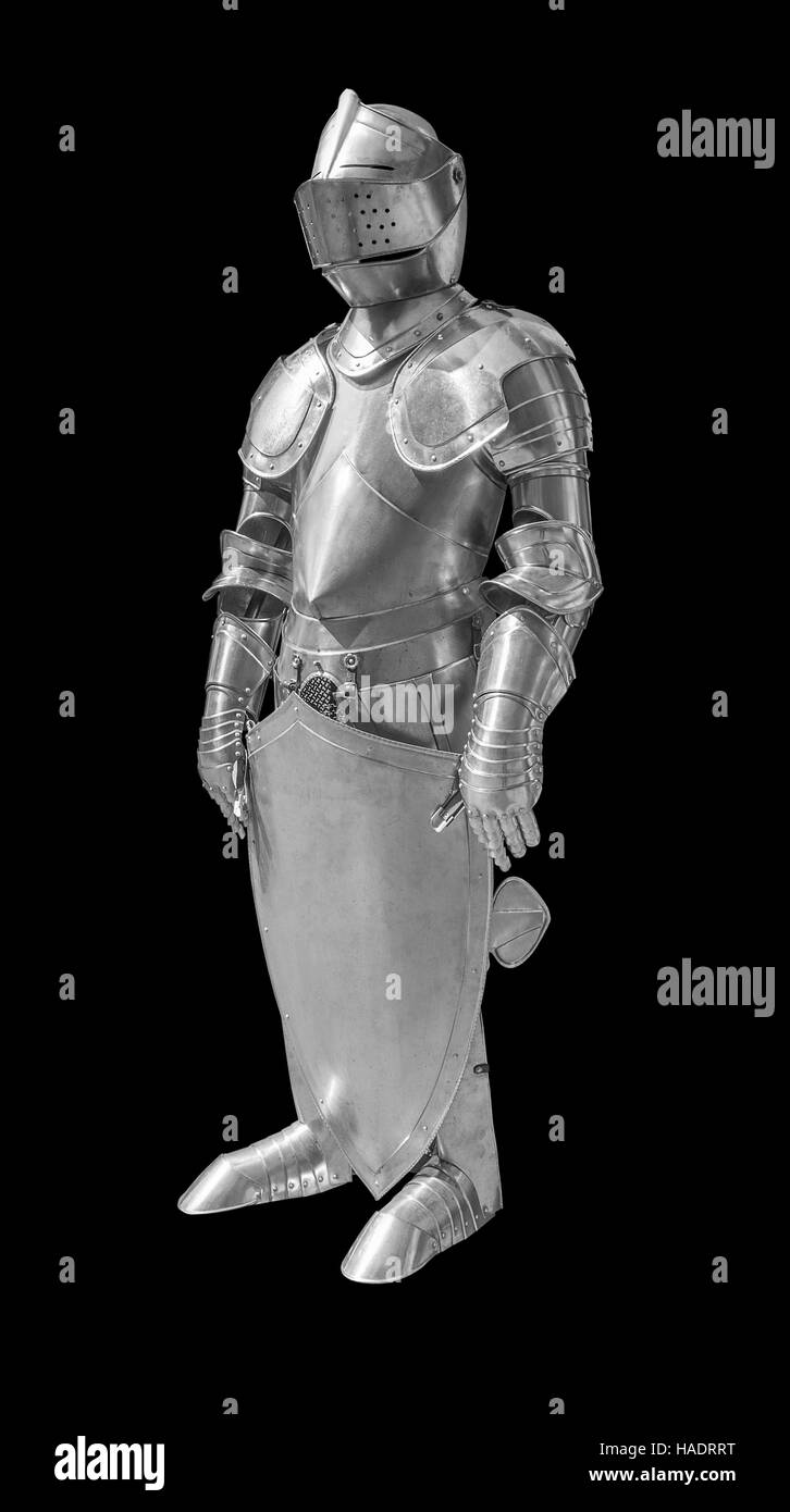 historic full body metallic plate armour in black back - Stock Image