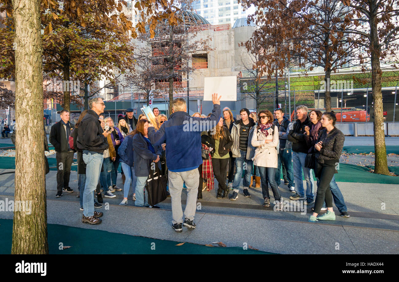 A tour guide lecturing a tour group on 9/11 - Stock Image