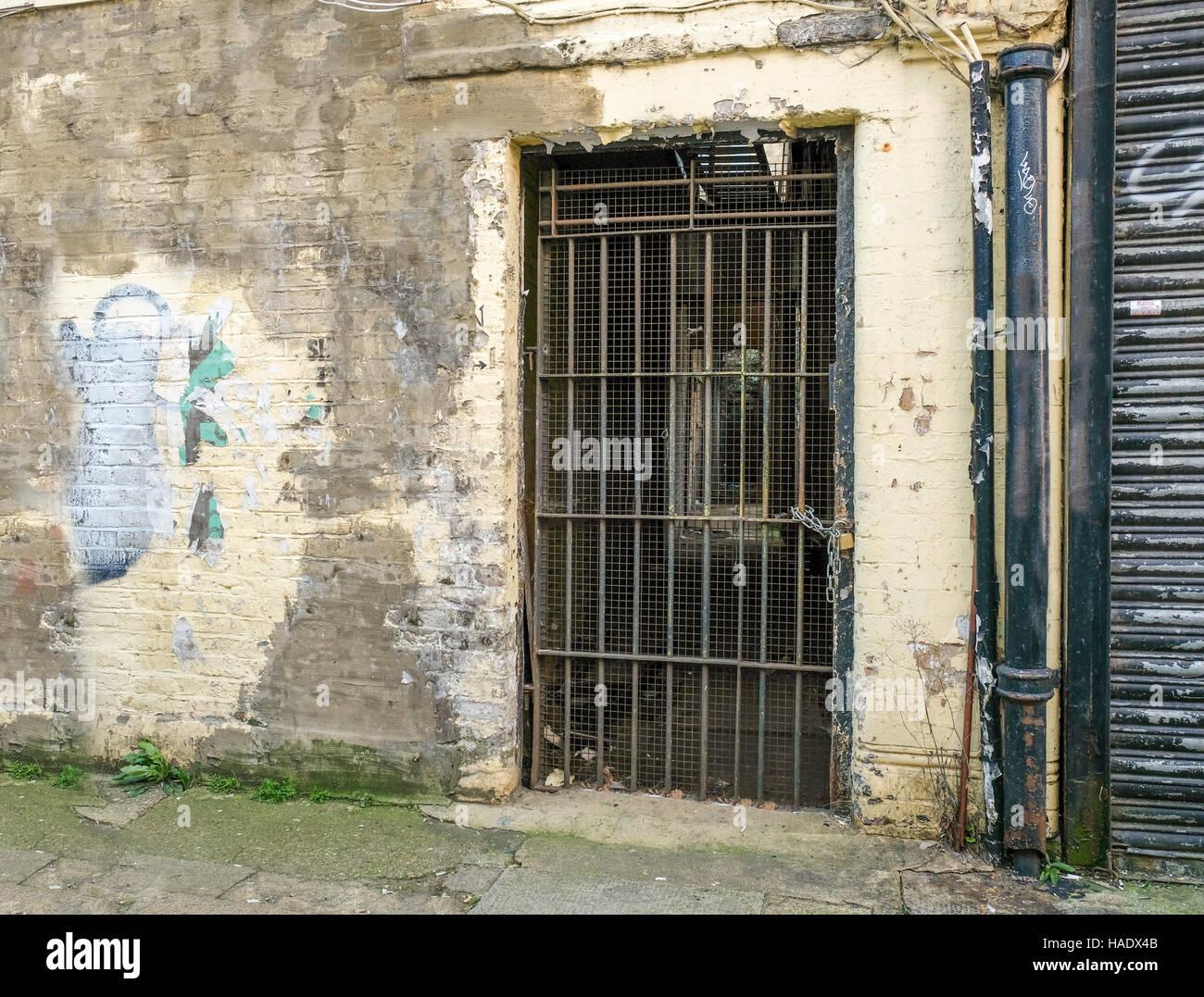 Old metal barred and grilled door way forgotten and abandoned & Old metal barred and grilled door way forgotten and abandoned Stock ...