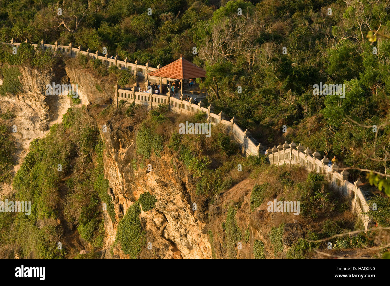 Cliffs next to the Ulu Watu temple Pura Luhur. Bali. Uluwatu Temple is a Hindu temple set on the cliff bank in south - Stock Image