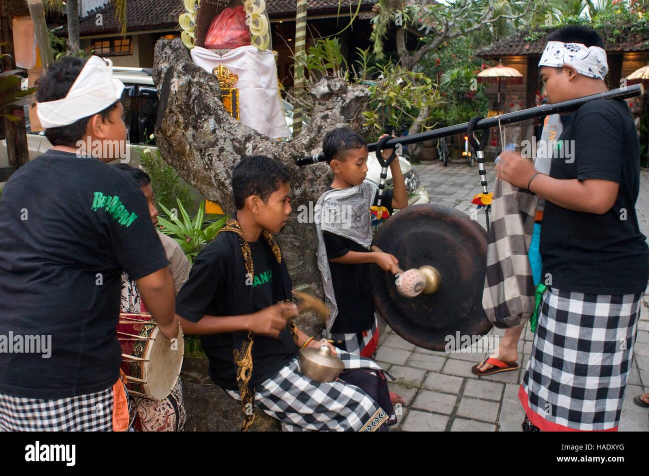 Galungan. Ubud Monkey forest. Ubud. Sacred Monkey Forest of Padangtegal. Several young people play music through - Stock Image