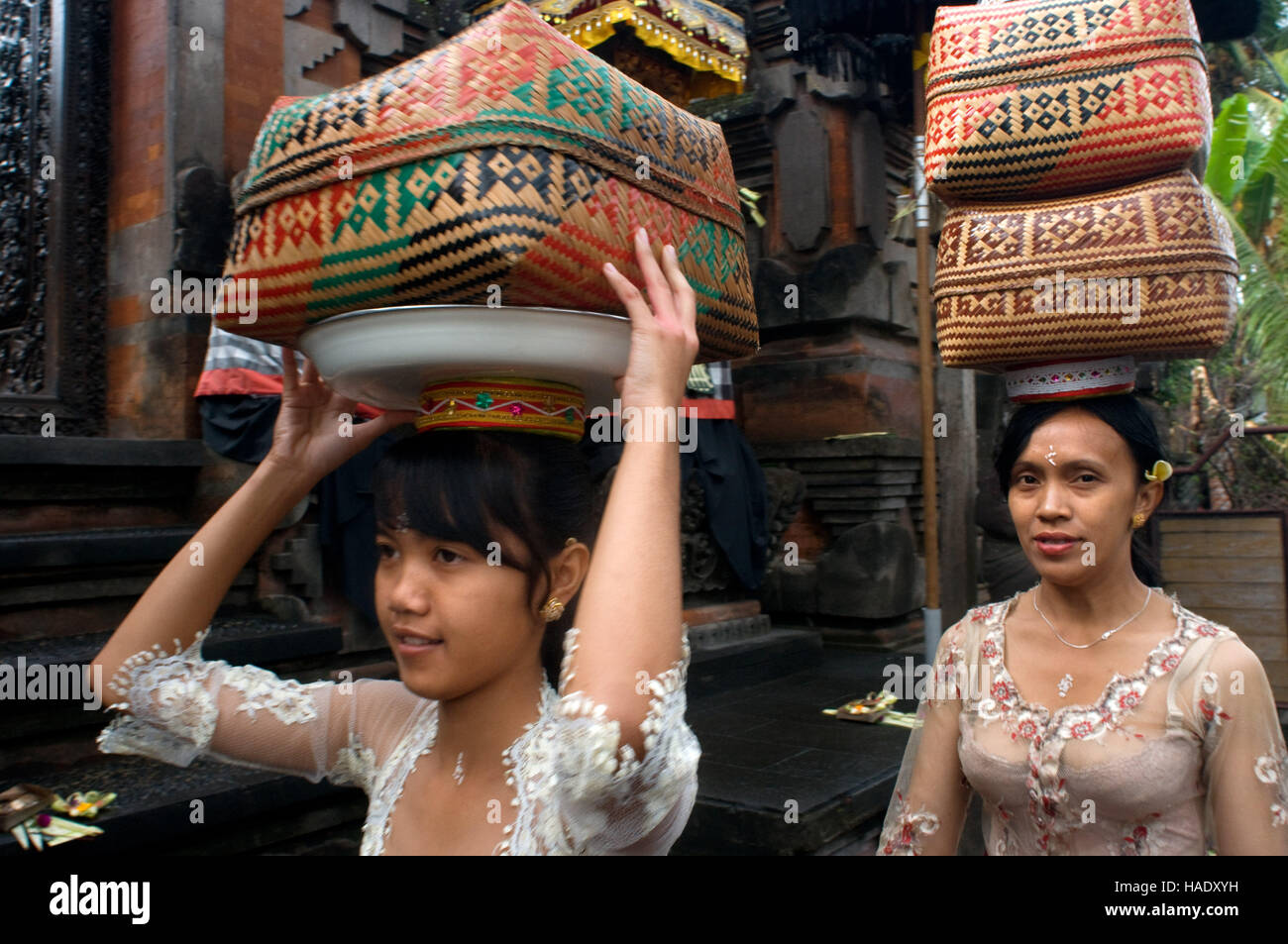 Many women turn to the Holy Book Monkey Forest to pray and leave offerings for the celebration of Galungan. Galungan - Stock Image