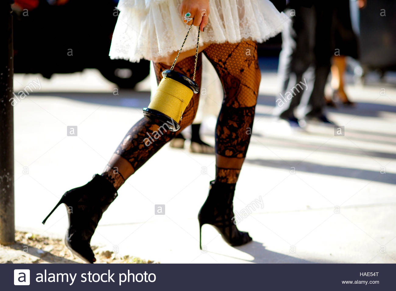 Detail of woman arriving for Chanel at the Grand Palais, on Ave Winston Churchill. SS17 FW16 Street Style Paris. - Stock Image