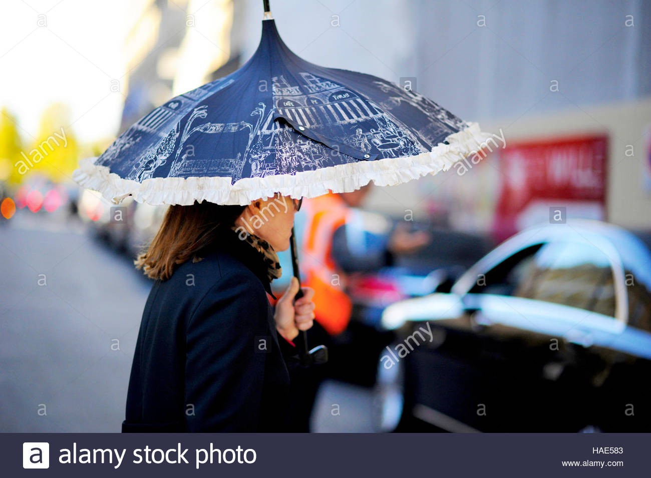 Woman with parasol, After Louis Vuitton at Place Vendome, SS17 FW16 Street Style Paris. - Stock Image