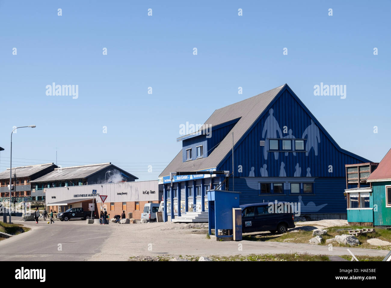 Street scene in town centre with World of Greenland Tourist Information office and shops. Ilulissat (Jakobshavn), - Stock Image