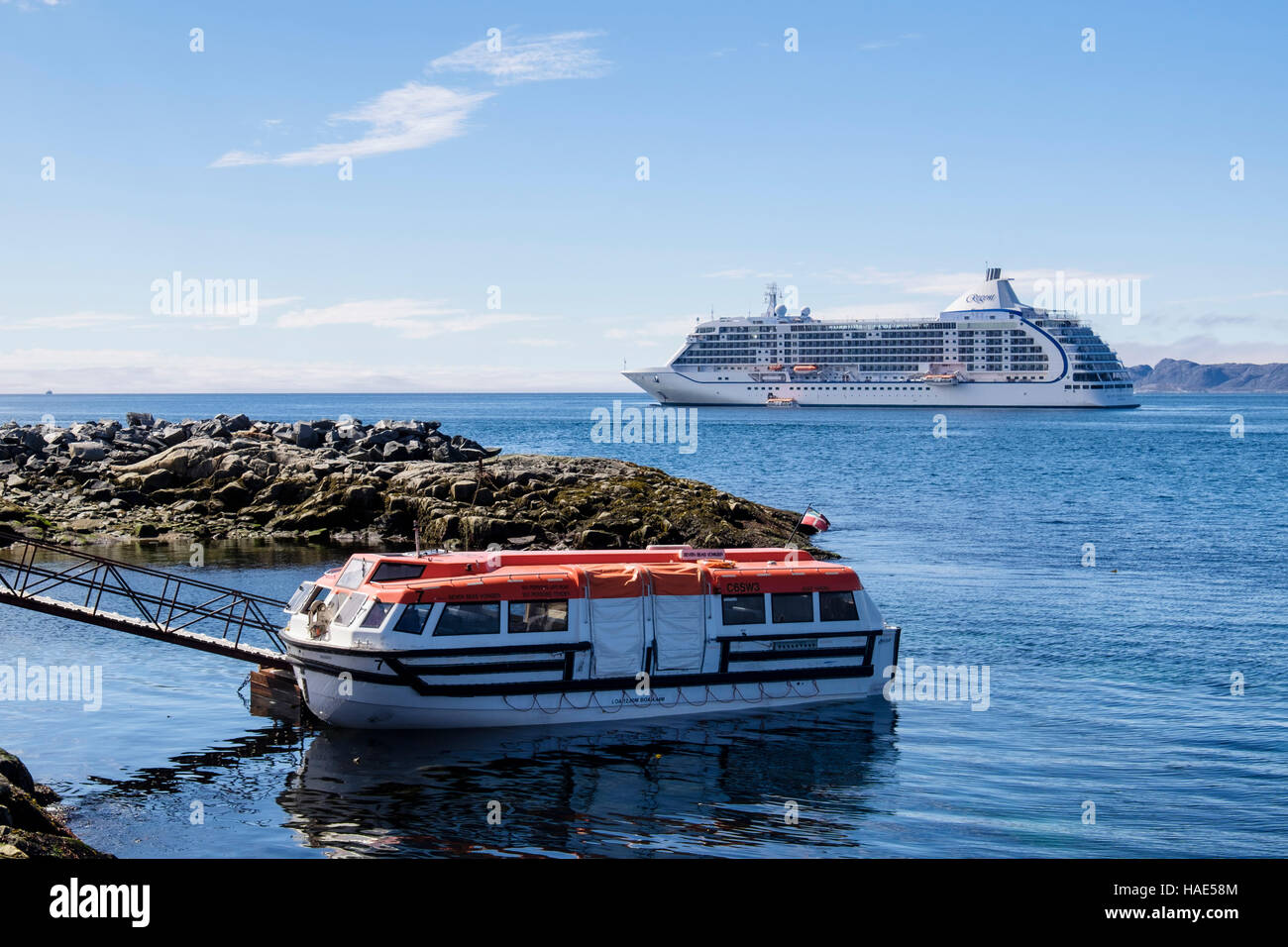 Tender boat carrying passengers ashore from ocean cruise liner Seven Seas Voyager moored offshore. Nuuk Western - Stock Image