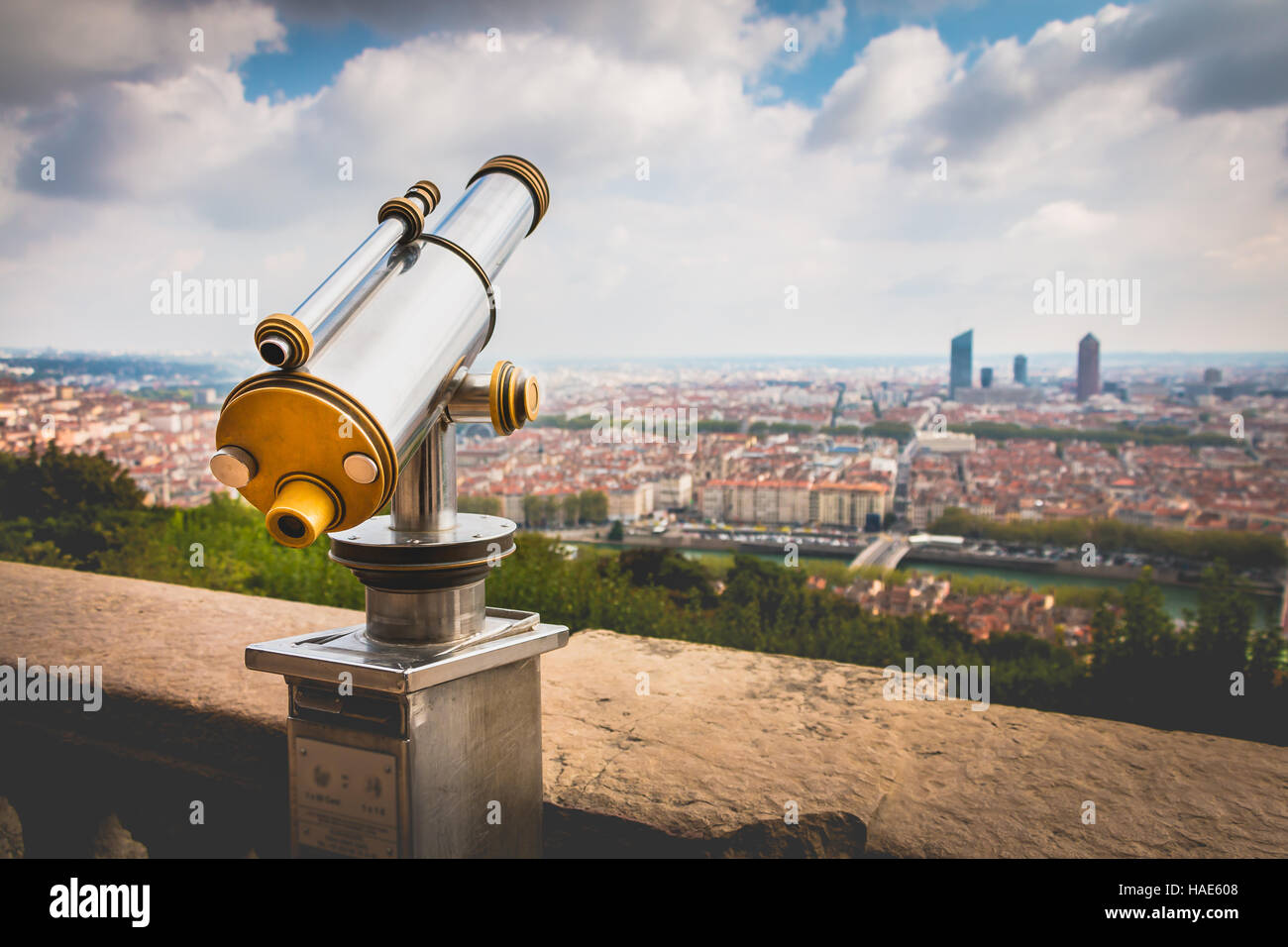 Telescope directed towards the city of Lyon in France Stock Photo