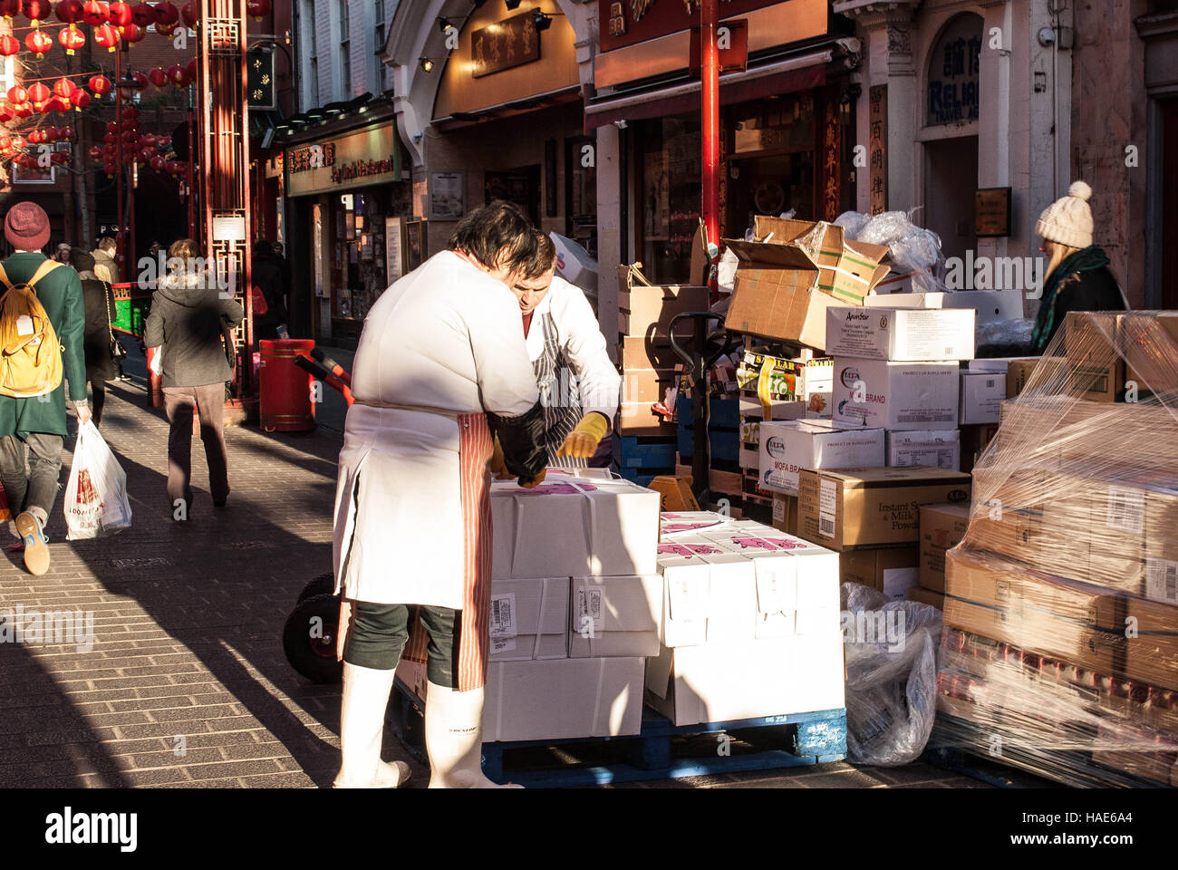 Unwrapping in China Town, London - Stock Image
