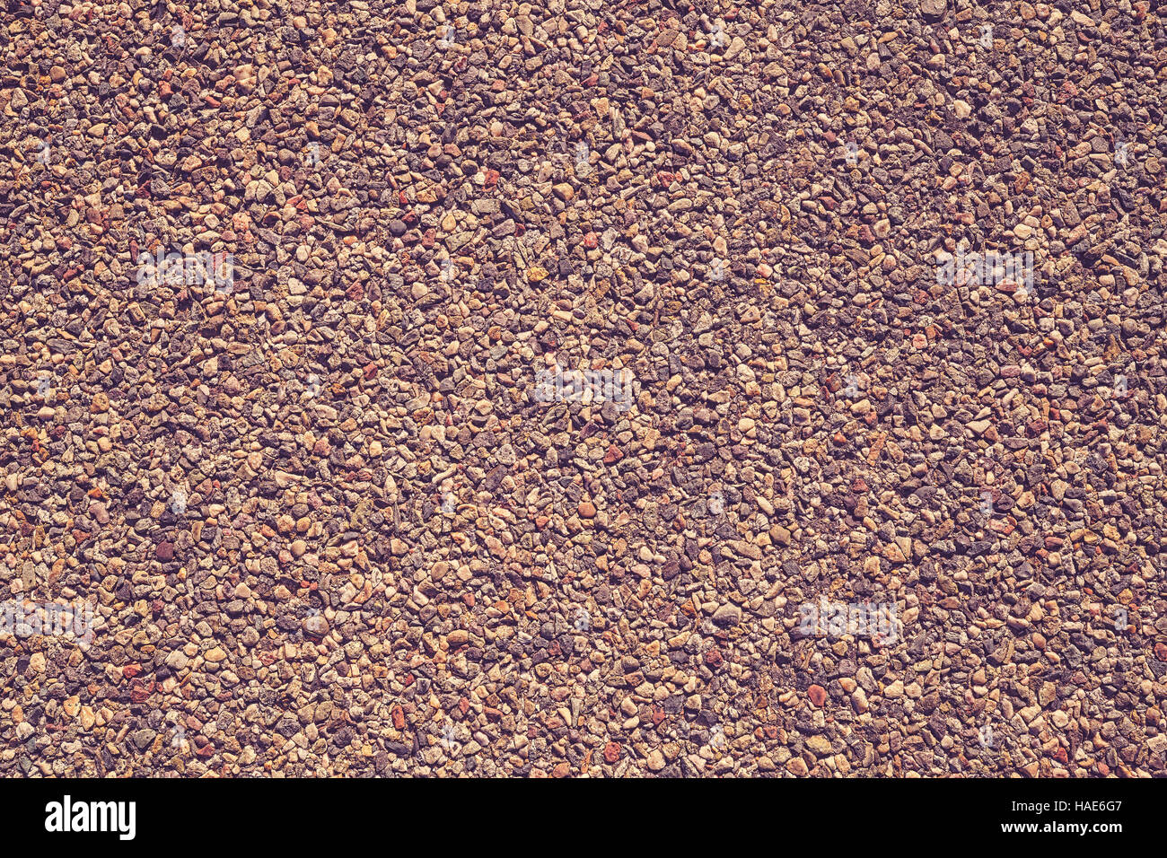 Color toned grit in asphalt, background or texture. - Stock Image