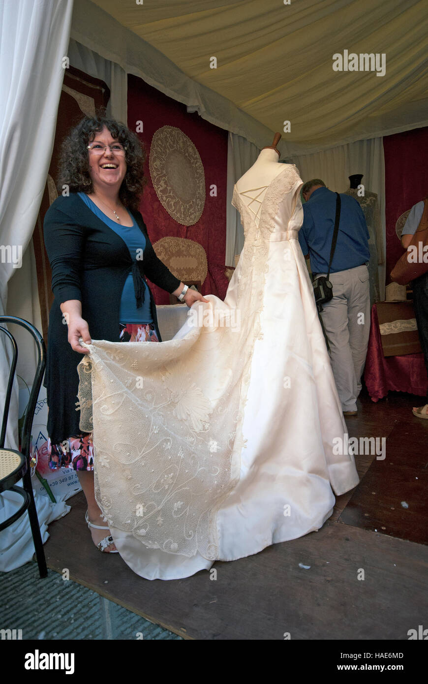 Wedding dress embroidered on tulle with the technique of the Ars Panicalensis, Panicale, Umbria, Italy Stock Photo