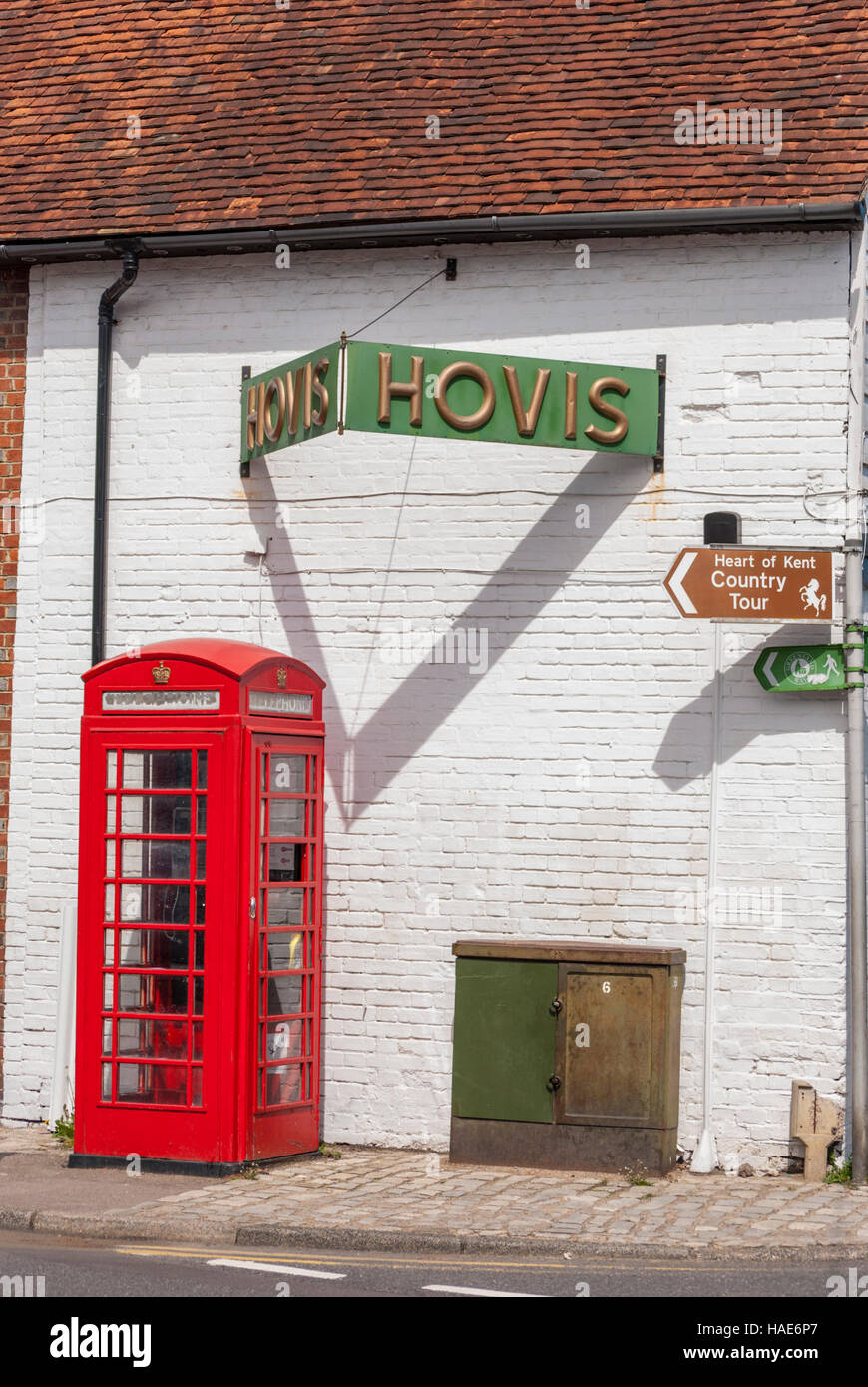Red phone box and Hovis advertising sign in Yalding village in kent. - Stock Image