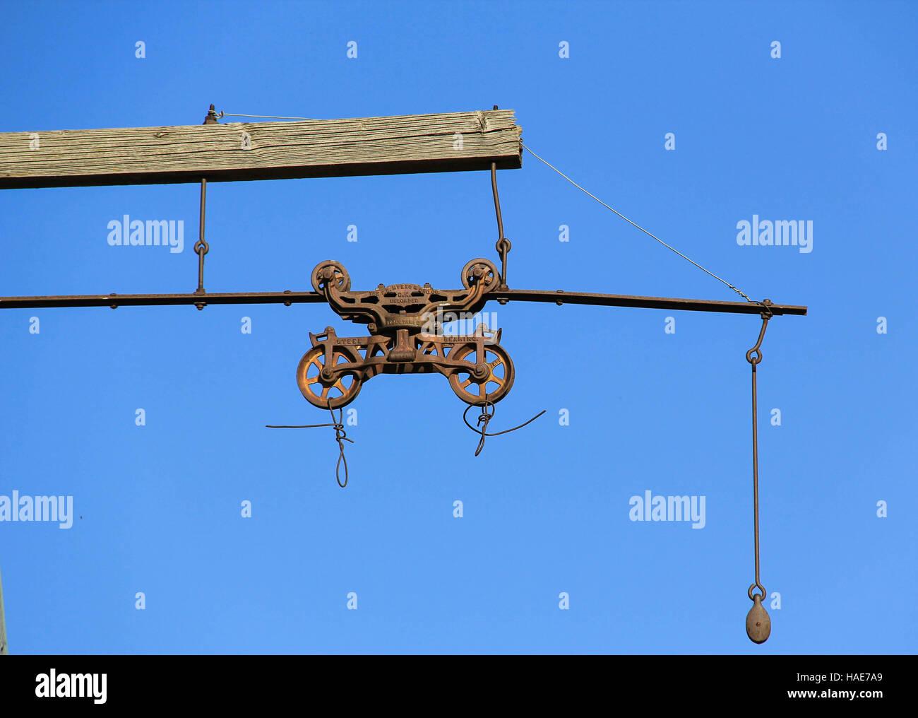 Hay trolley extending from  hayloft on barn in Ogden Valley, Utah - Stock Image
