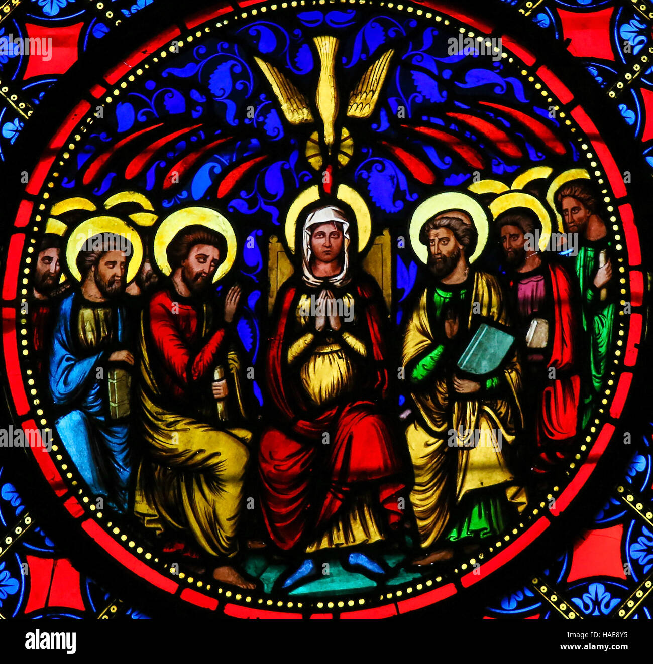 Stained Glass window in the Cathedral of Bayeux, France, depicting Mother Mary and the Apostles at Pentecost - Stock Image